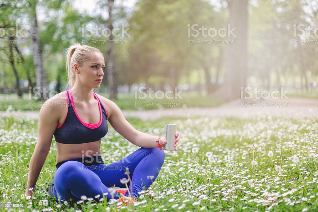 young girl relaxing and sitting in nature stock photo