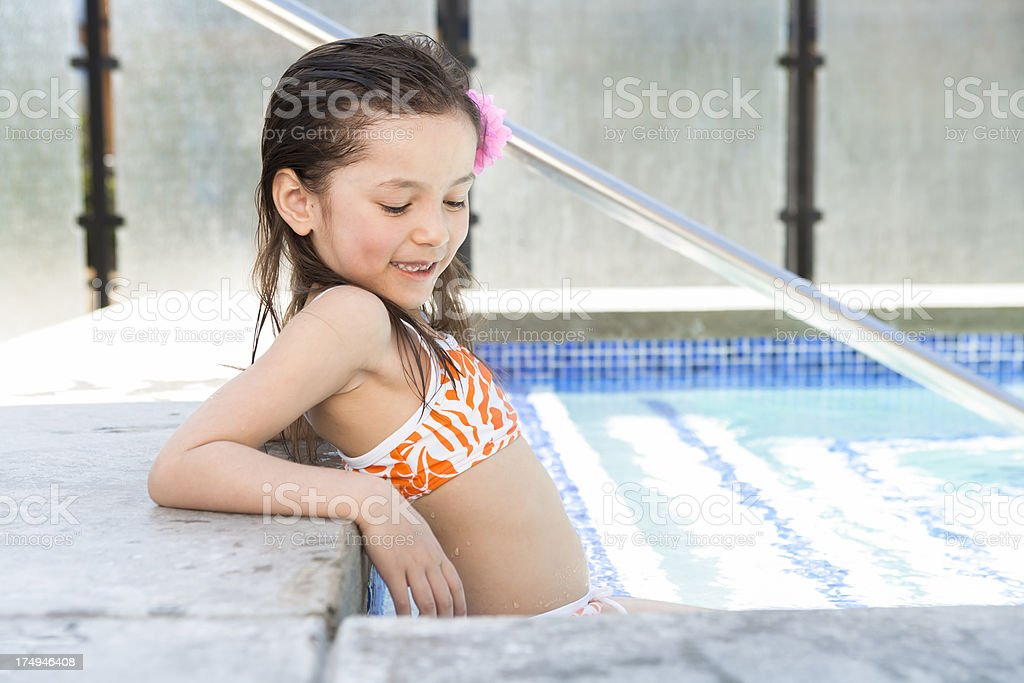 Young girl relaxing in the hot tub royalty-free stock photo