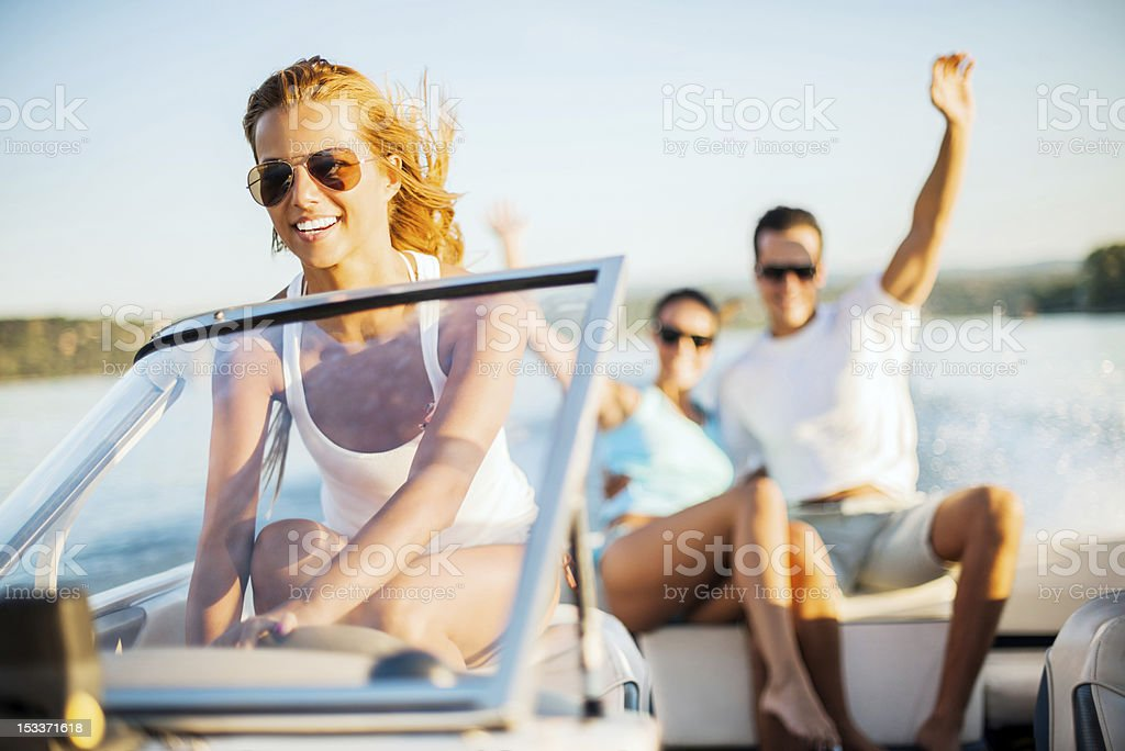 Young girl riding a speedboat royalty-free stock photo
