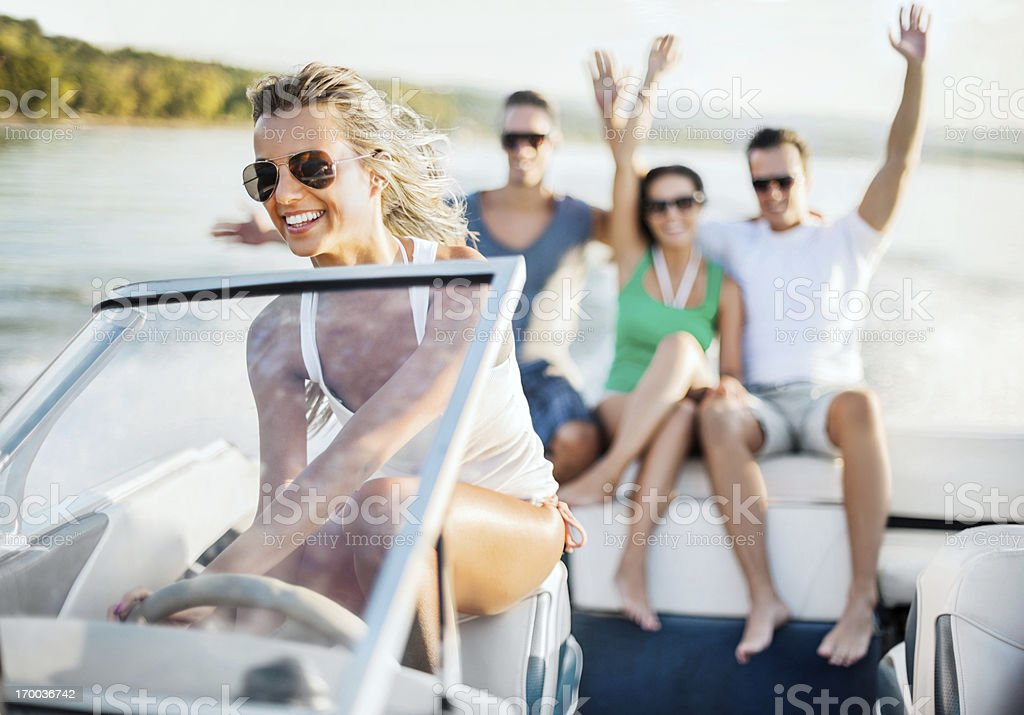 Young girl riding a speedboat stock photo