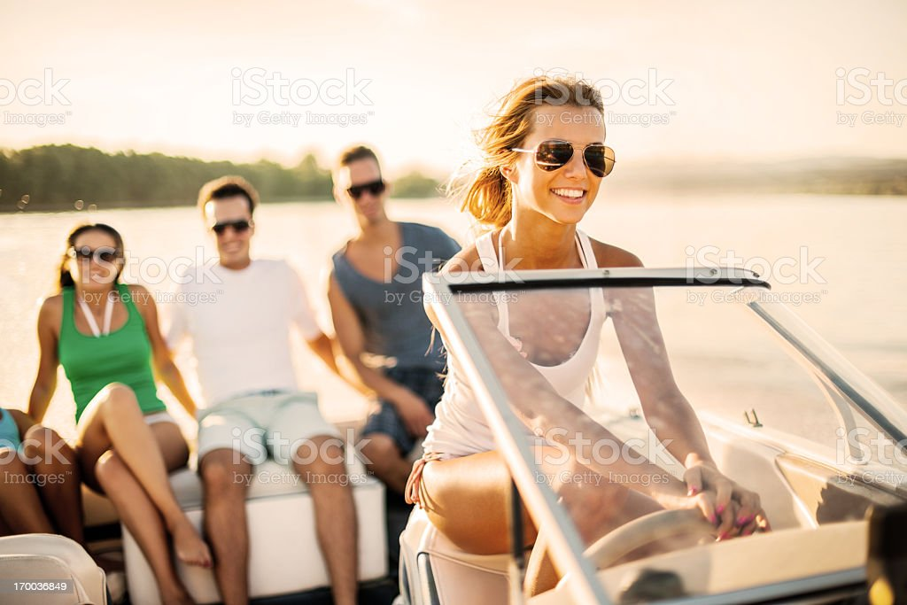 Young girl riding a speedboat. stock photo