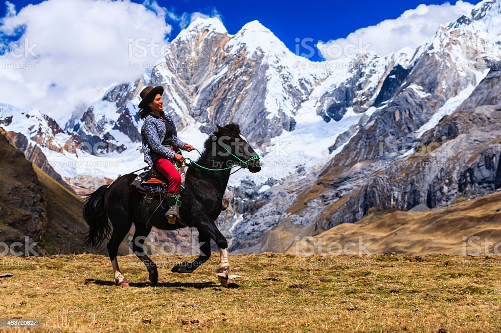 Young girl riding horse in Peruvian Andes, South America stock photo
