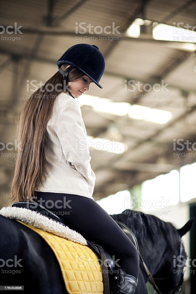 Young girl riding horse royalty-free stock photo