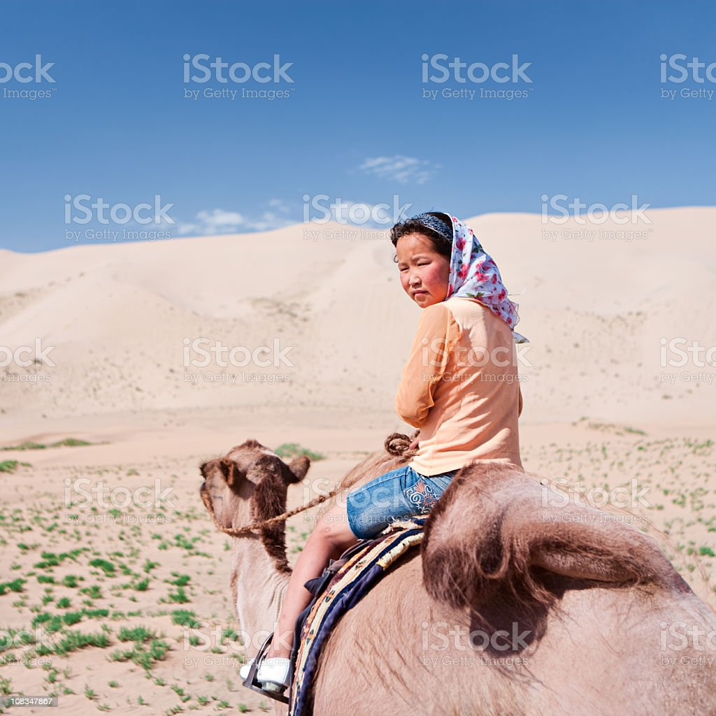 Young girl riding on the camel royalty-free stock photo