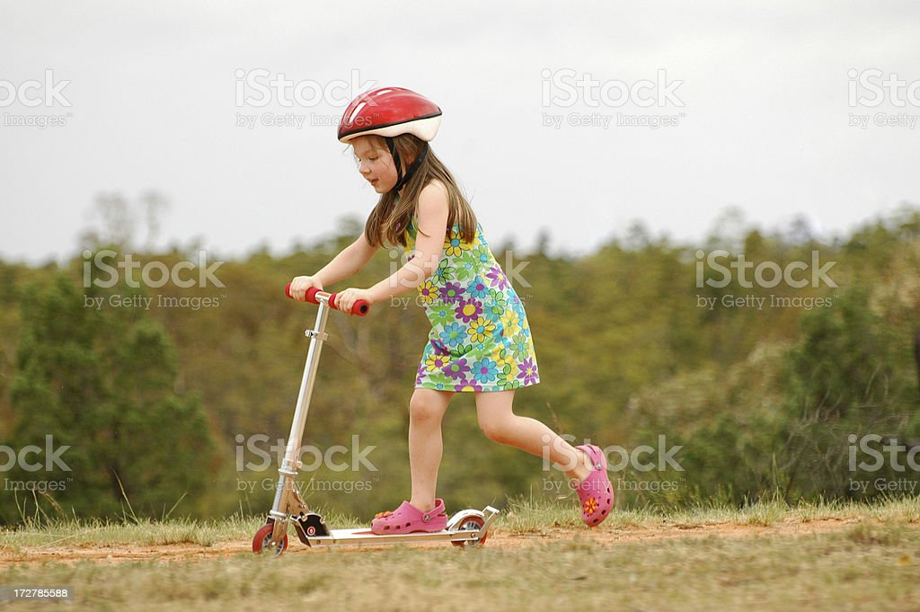 Young girl riding scooter royalty-free stock photo