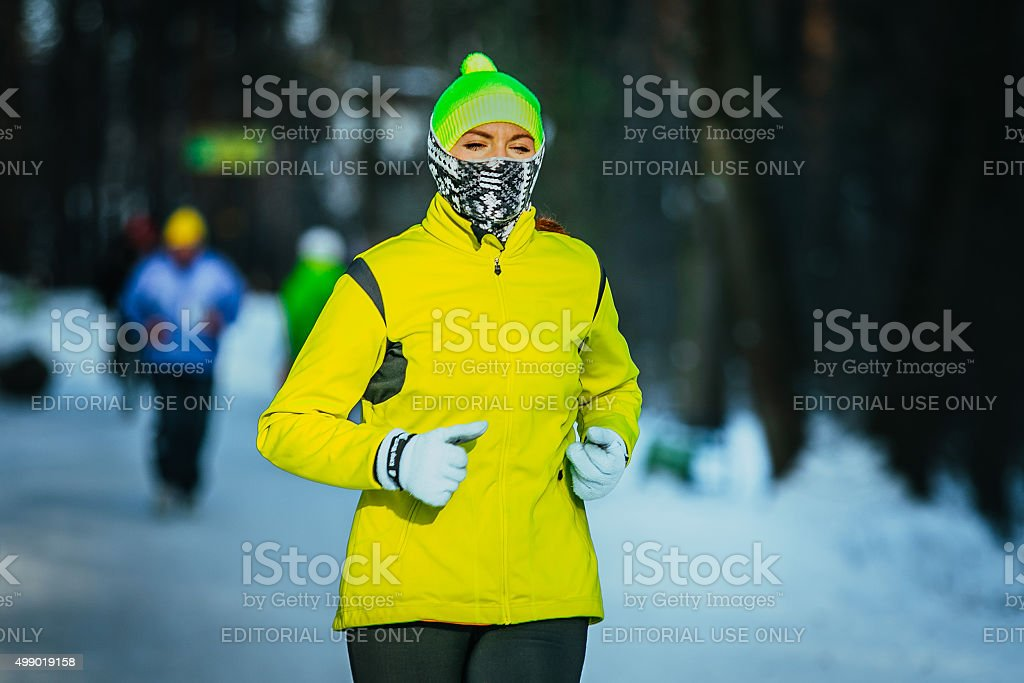 young girl running in a winter Park stock photo