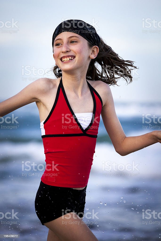 Young girl running on beach royalty-free stock photo