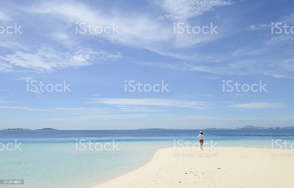 young girl running on tropical beach royalty-free stock photo
