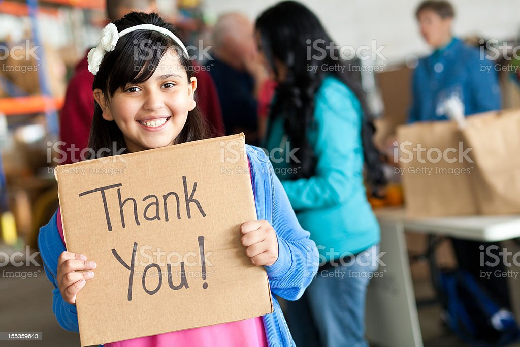 Young girl saying Thank You at a donation center royalty-free stock photo