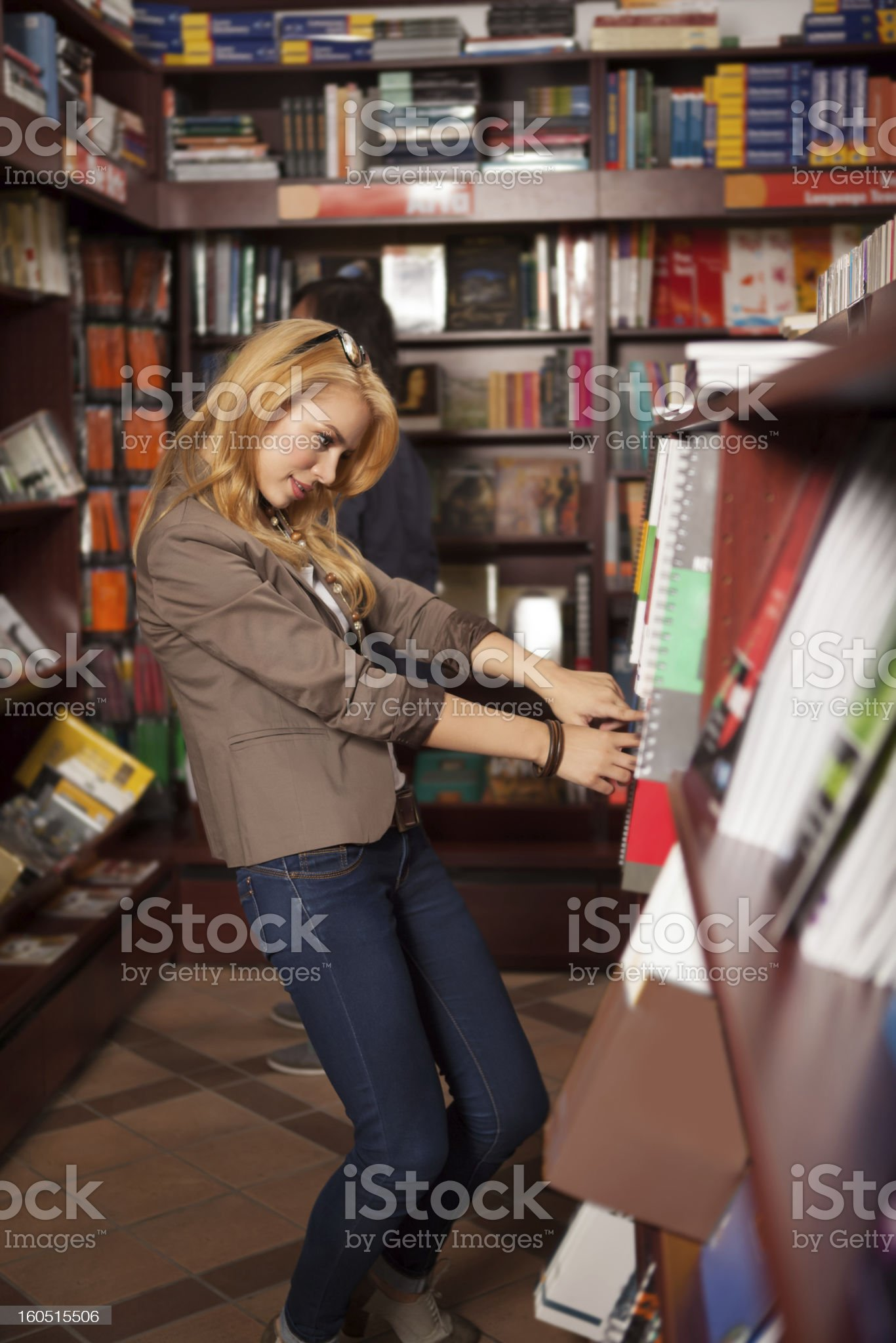 young girl searching for a specific book royalty-free stock photo