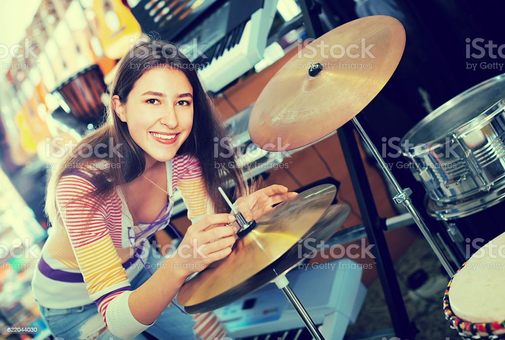 Young girl selecting drums and accessories stock photo