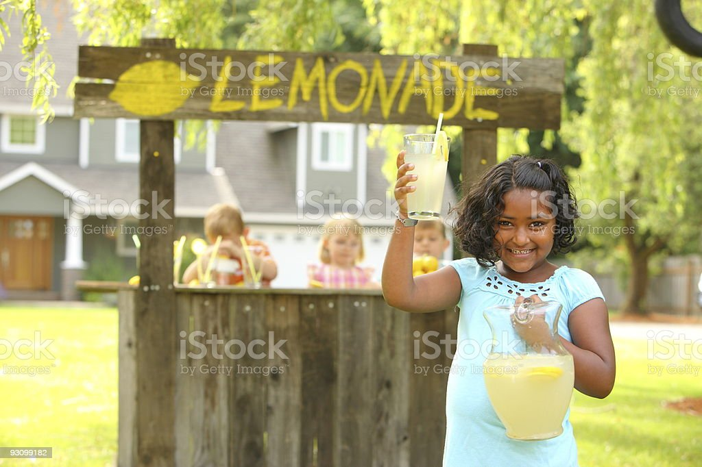 Young girl selling lemonade on a stand stock photo