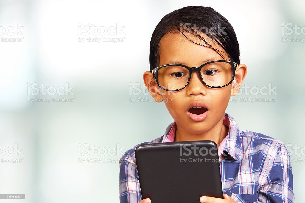 Young Girl Shocked Looking Her Tablet stock photo