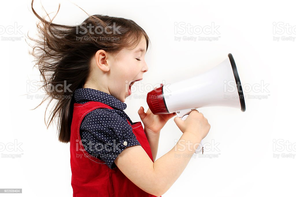 Young girl shouting over a megaphone royalty-free stock photo