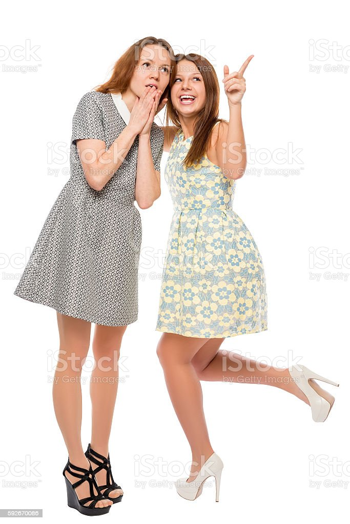 Young girl showing her friend something to the top stock photo