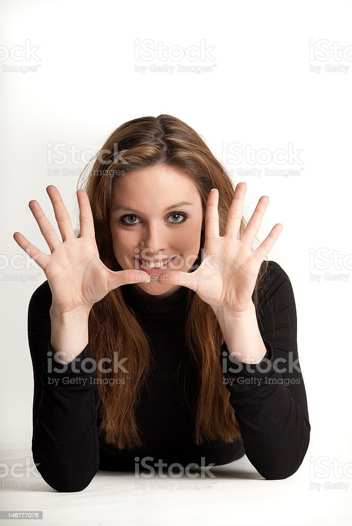 Young girl showing ten fingers royalty-free stock photo
