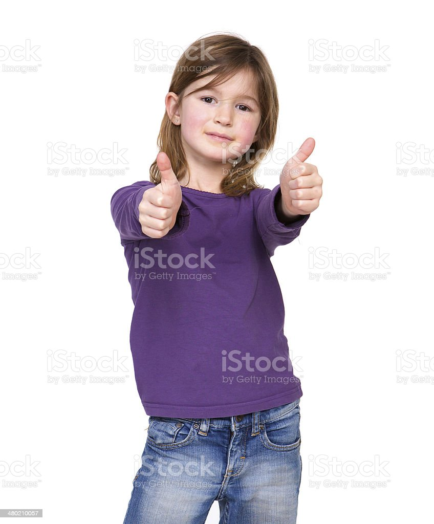 Young girl showing thumbs up stock photo