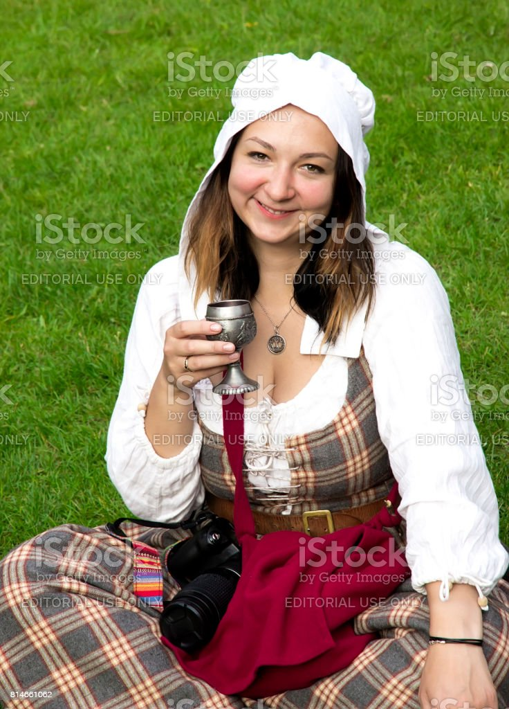 Young girl sits on the grass.Festival of Scottish Culture stock photo