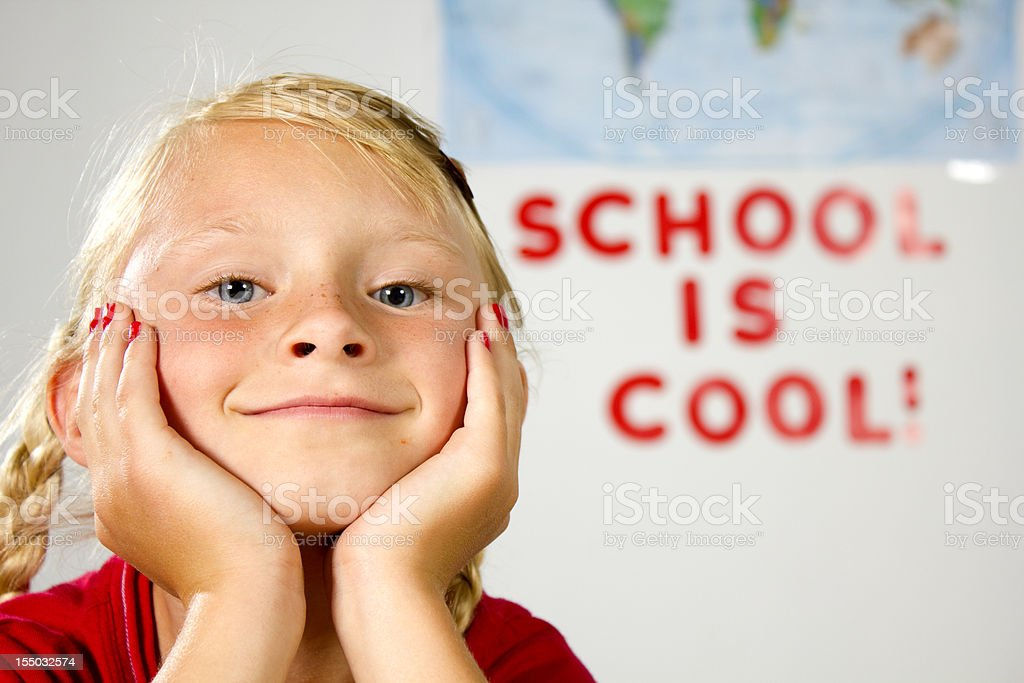Young girl sitting in class with a smile stock photo