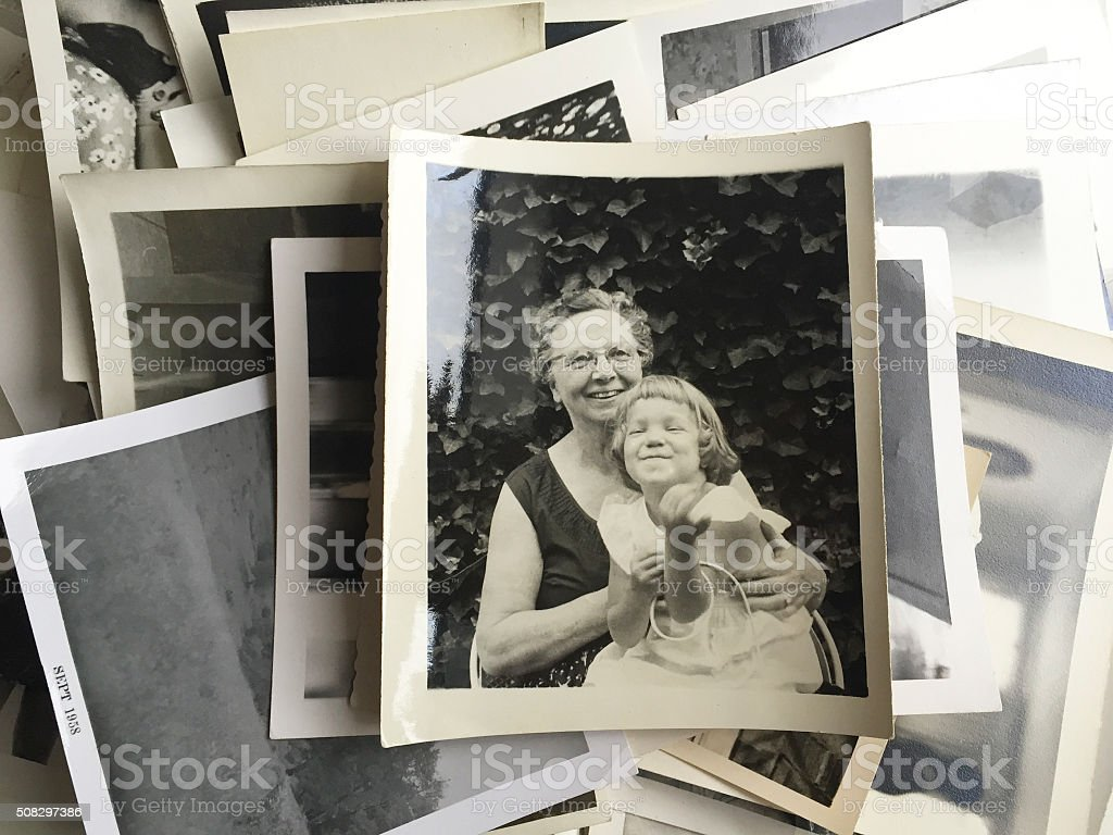 Young Girl sitting in her Grandmother's Lap stock photo