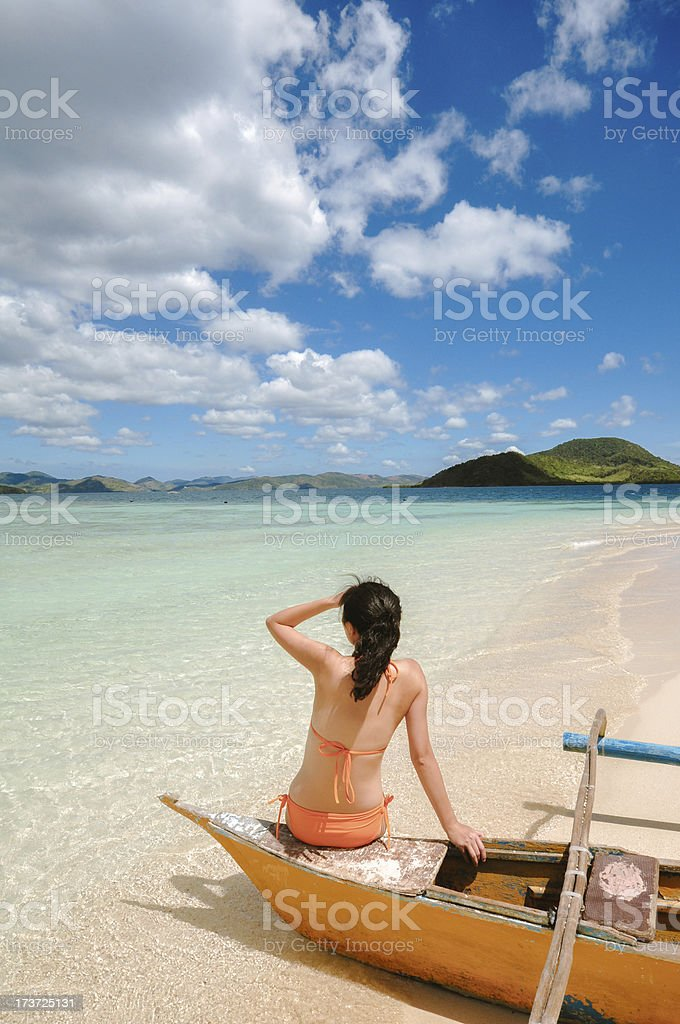 young girl sitting on beach boat royalty-free stock photo