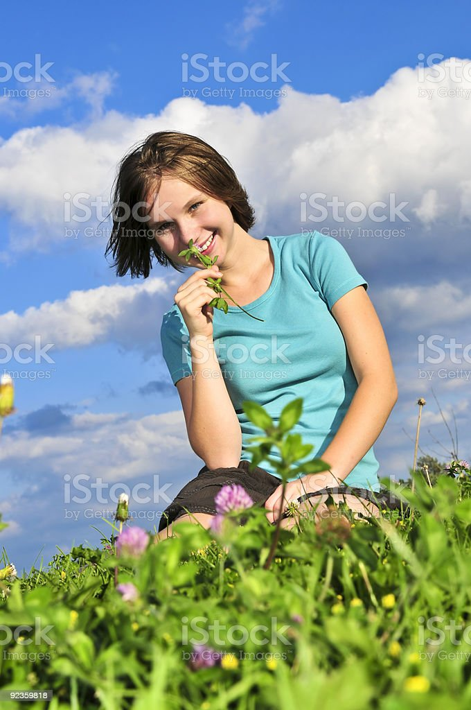 Young girl sitting on grass royalty-free stock photo