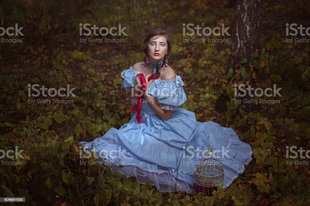 Young girl sitting on the grass. stock photo
