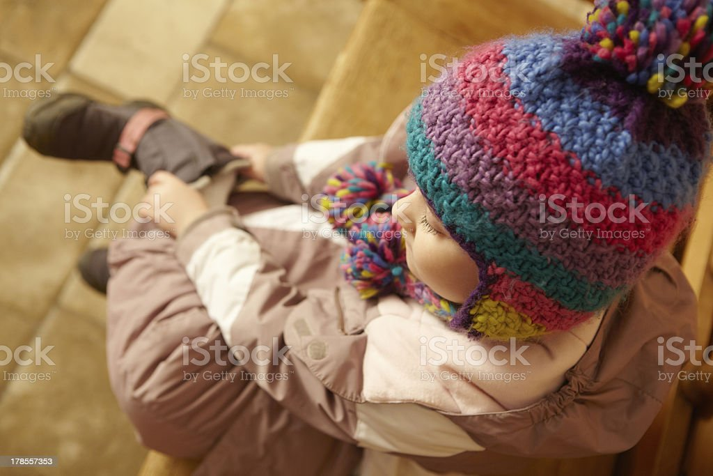 Young Girl Sitting On Wooden Seat stock photo