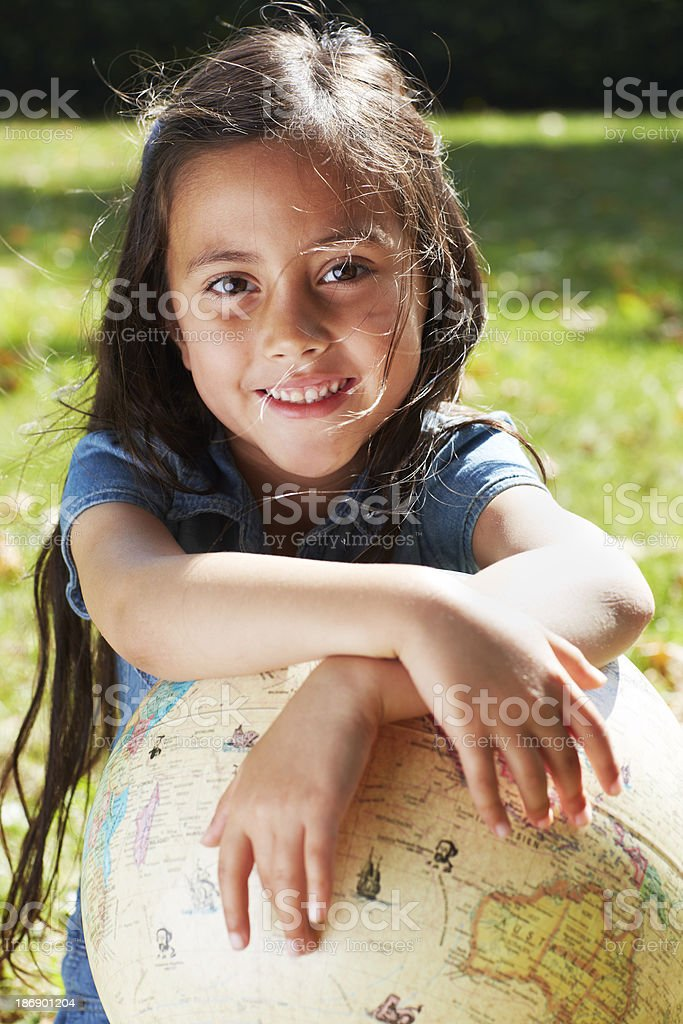 Young girl sitting with globe, portrait royalty-free stock photo