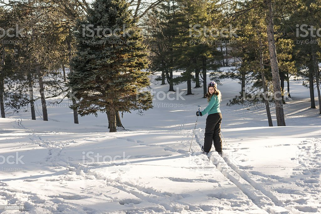 Young girl skiing in wilderness stock photo