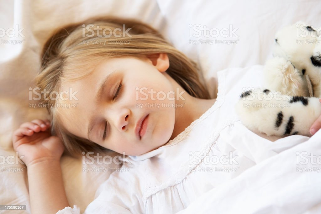 Young Girl Sleeping In Bed royalty-free stock photo