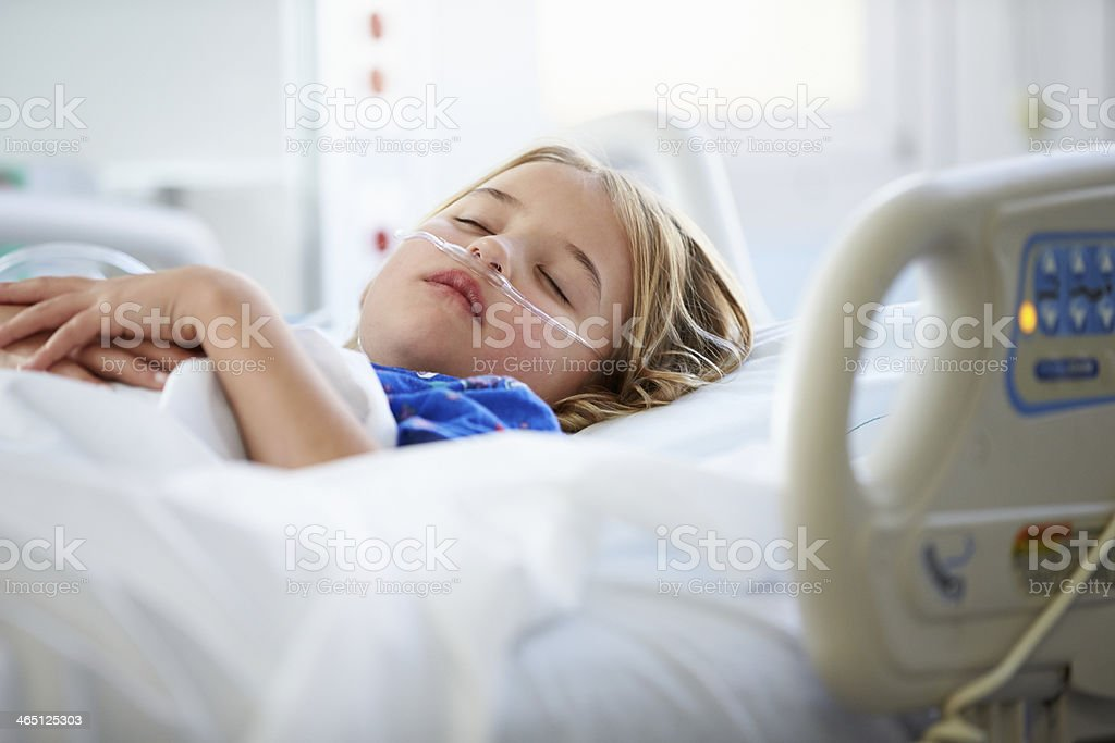 Young Girl Sleeping In Intensive Care Unit stock photo