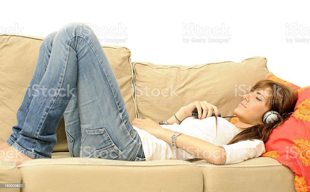 young girl sleeping with music stock photo