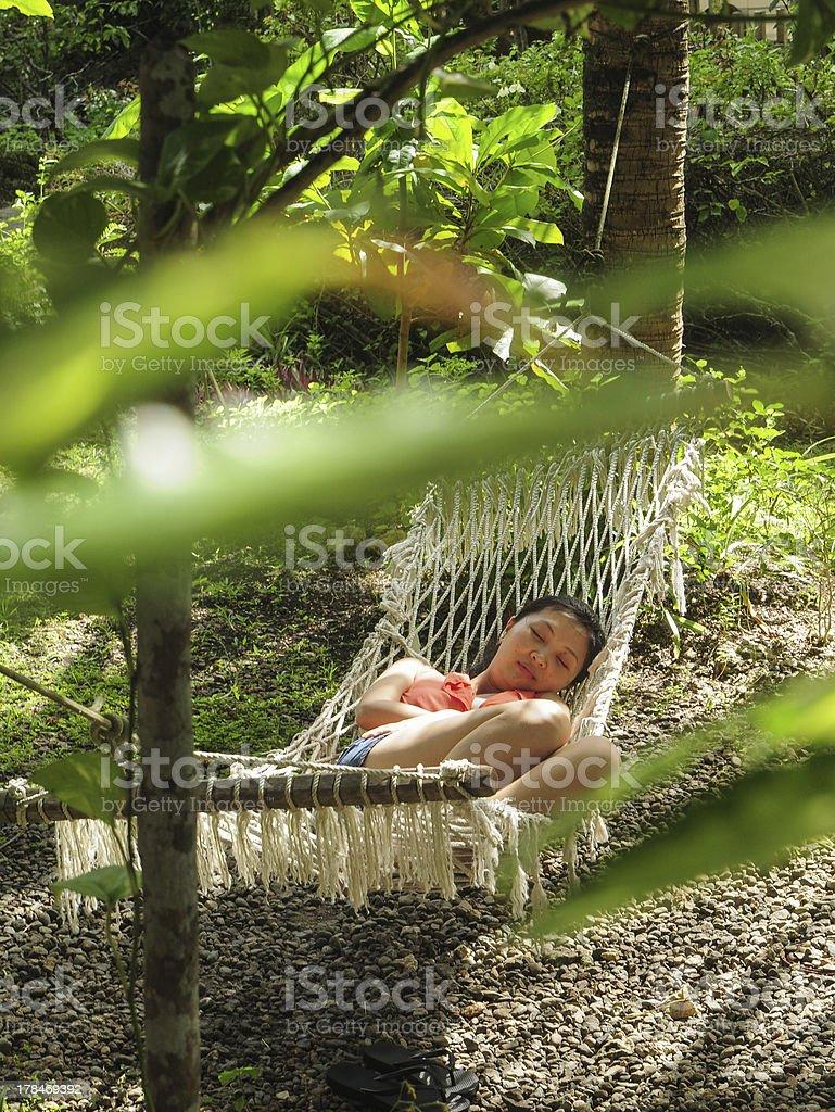 young girl sleeps in hammock royalty-free stock photo