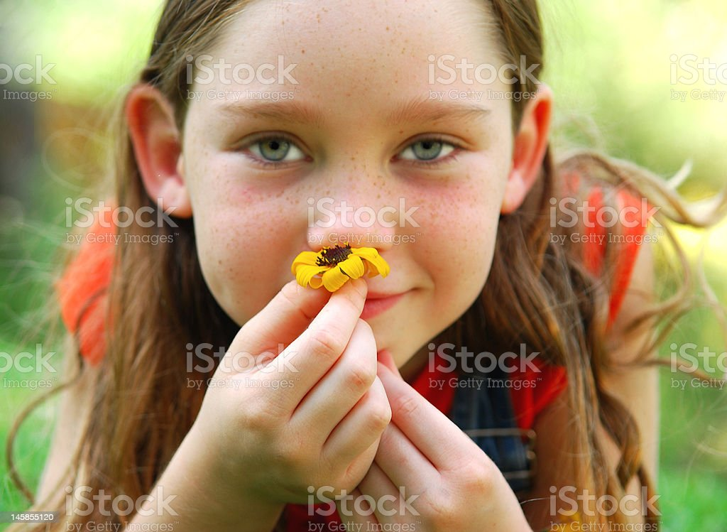 Young Girl Smelling Wildflower royalty-free stock photo