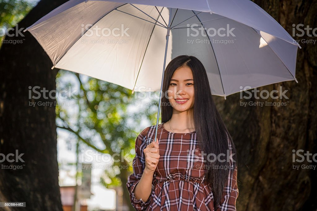 young girl smile hold white umbrella stock photo