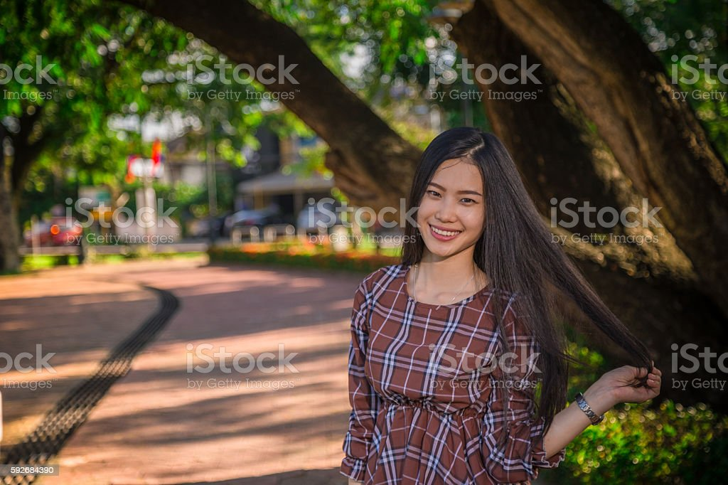 young girl smile park stock photo