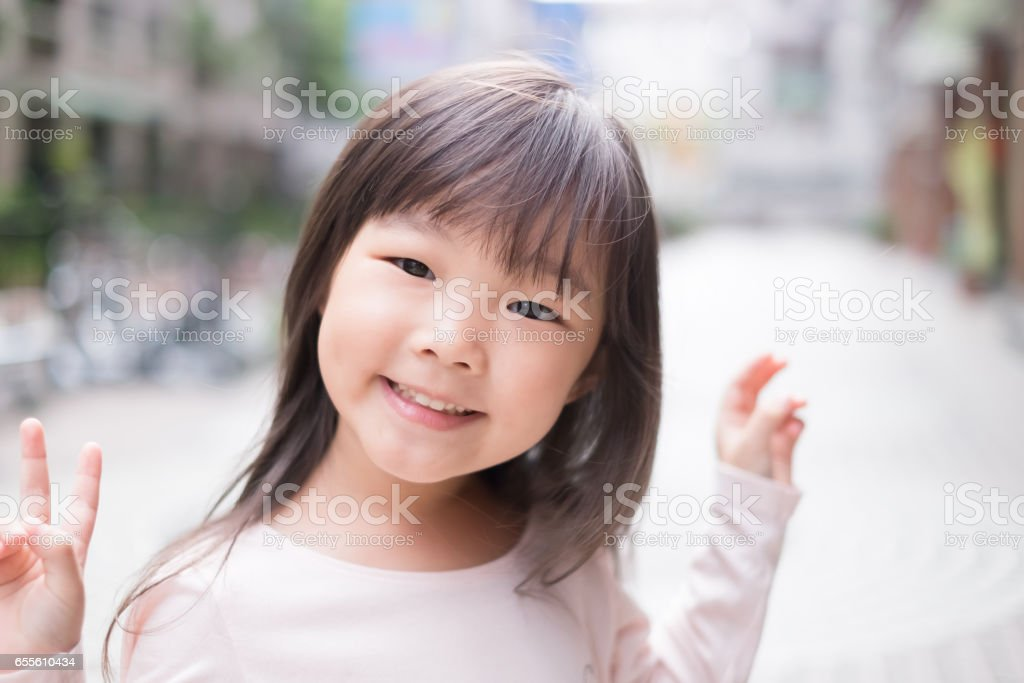 young girl smile to you stock photo