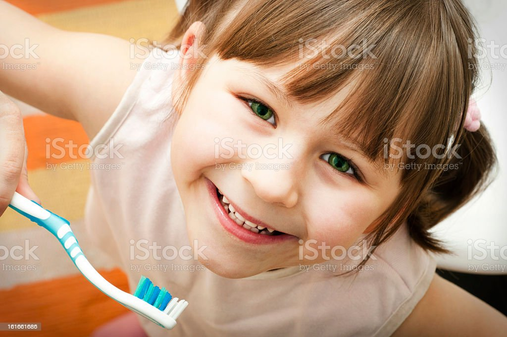 A young girl smiling after brushing her teeth royalty-free stock photo