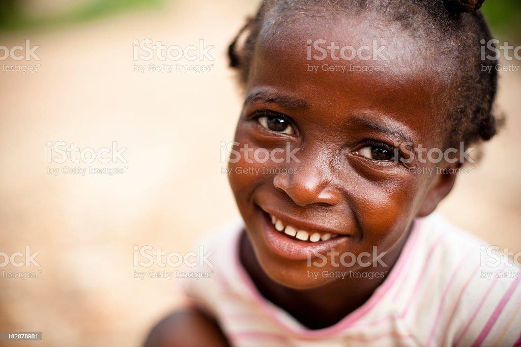 Young girl smiling at the camera royalty-free stock photo