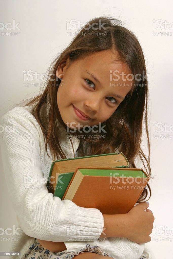 Young girl smiling & holding books royalty-free stock photo