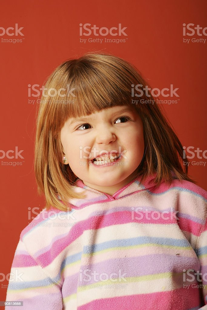 Young Girl smiling in a stripe sweather stock photo
