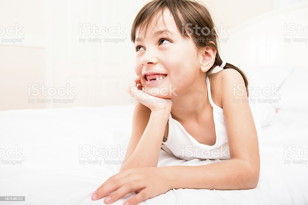Young girl smiling in bed royalty-free stock photo