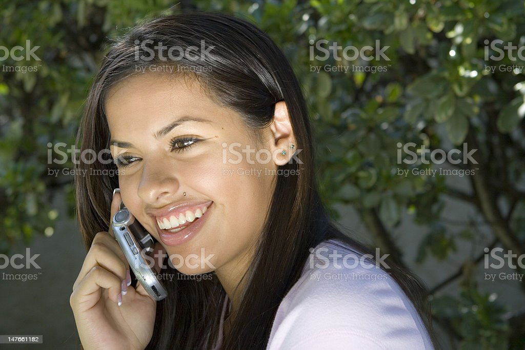 Young Girl Smiling on the Phone stock photo