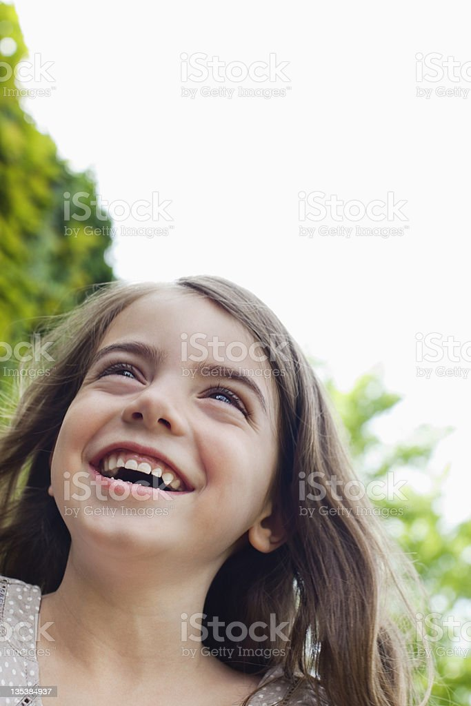Young girl smiling outdoors royalty-free stock photo