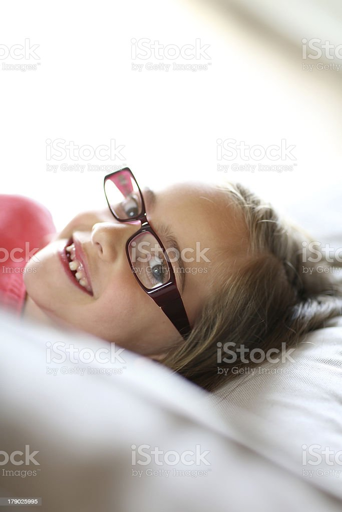 Young girl smiling with eyeglasses royalty-free stock photo
