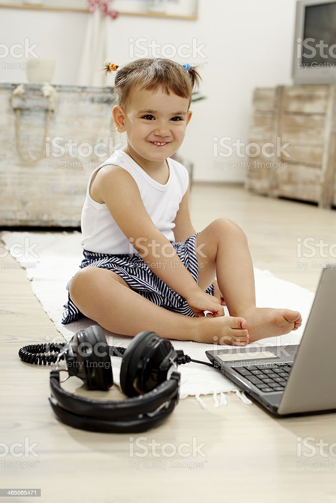 young girl smiling with  laptop royalty-free stock photo
