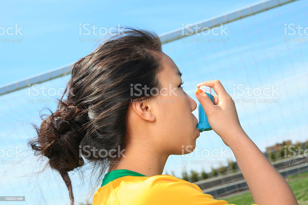 Young Girl Soccer - Asthma Inhaler royalty-free stock photo