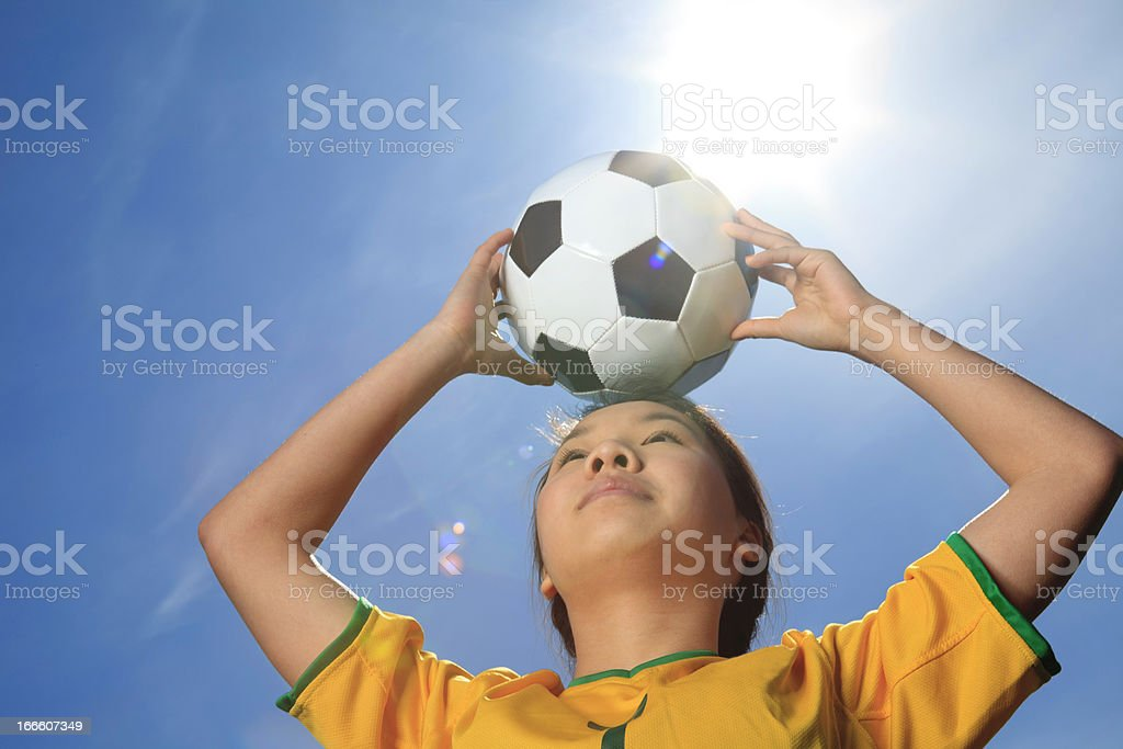 Young Girl Soccer - Ball on Head royalty-free stock photo
