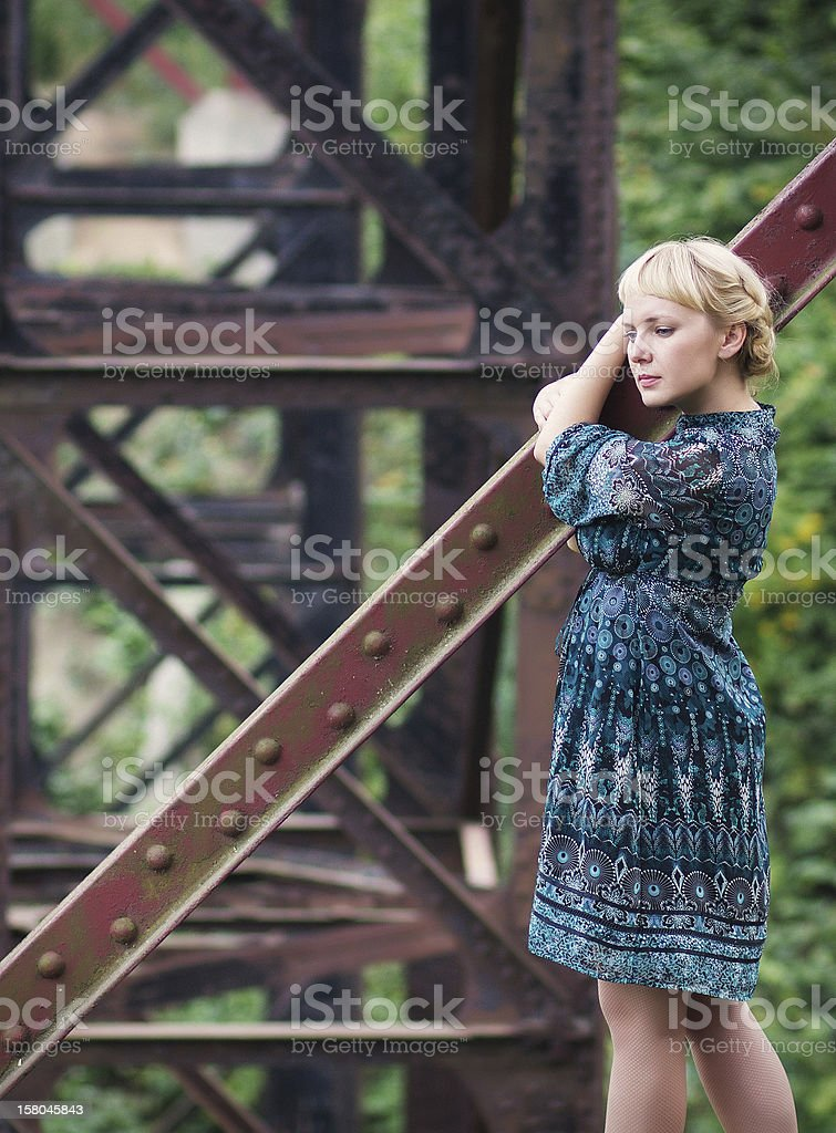 young girl standing on bridge bearing royalty-free stock photo